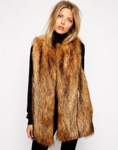 http://www.asos.de/ASOS/ASOS-Vintage-Longline-Faux-Fur-Gilet/Prod/pgeproduct.aspx?iid=3904208&WT.ac=rec_viewed