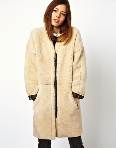 http://de.sheinside.com/Apricot-Long-Sleeve-Faux-Fur-Zipper-Coat-p-182582-cat-1735.html